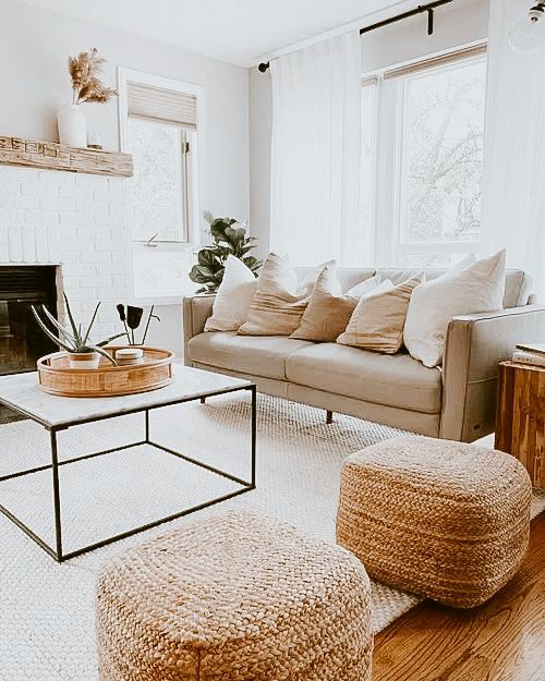 two jute poufs next to couch