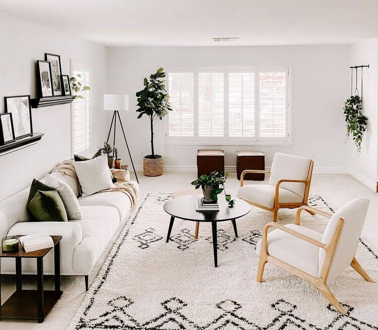 living room with sofa and two accent chairs