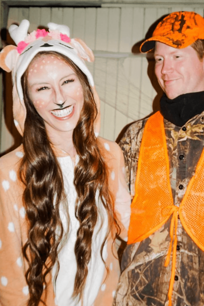 couple costume deer and hunter