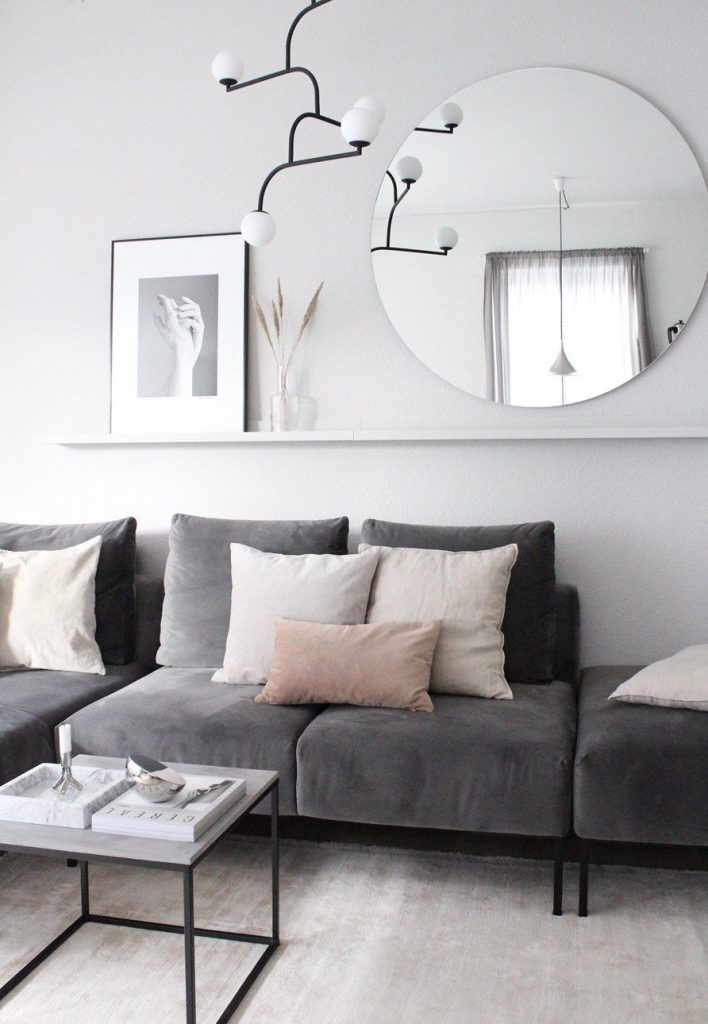 decorating with mirrors over sofa